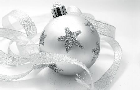 Christmas toy - a ball in stars with silver tape around Stock Photo