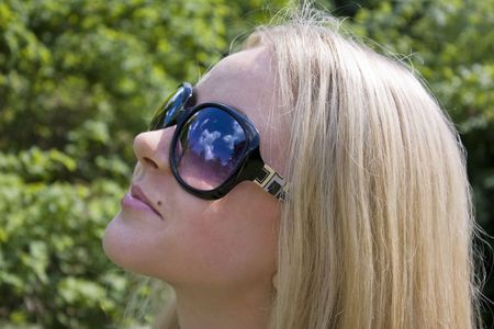 Attractive young blond woman in sunglasses  Stock Photo