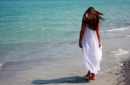 nymph: Young woman in long white dress, on the Aegean Sea. Greece Stock Photo