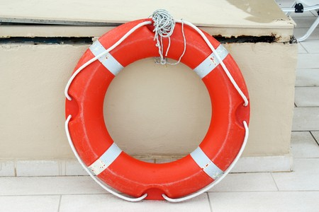 savers: Lifebuoy Attached to a Wall  Stock Photo