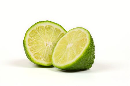 two and a half: Two half of lime isolated on white background