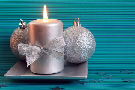Christmas candle and two silver balls