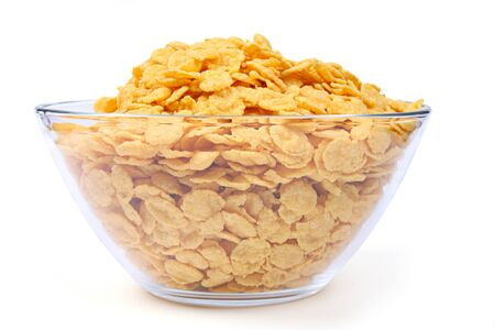 Corn flakes in bowl isolated on white