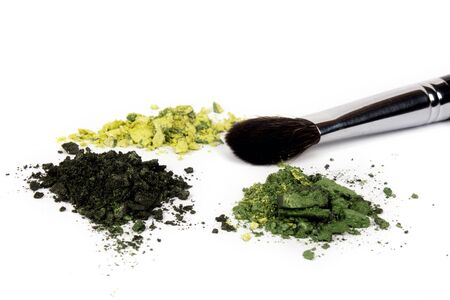 Green eyeshadow palette with brush on white background