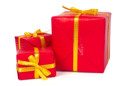 Three red gift boxes with yellow bows