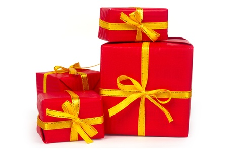 isolates: Red presents with with yellow ribbon on white background Stock Photo