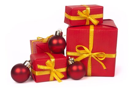 Stack of red gift boxes and christmas balls isolated on white background