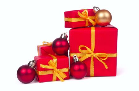 Christmas gifts with red and golden balls isolated on white background