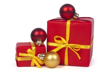 Christmas gifts with red and golden  balls isolated on white  Stock Photo