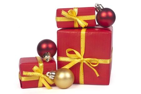 Christmas gifts with red and golden balls isolated on white background  Stock Photo