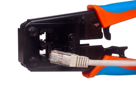 Network cable crimper isolated on white Editorial
