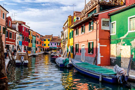 Venice, Italy - October, 2017: Colorful houses on Burano, island in the Venetian Lagoon.