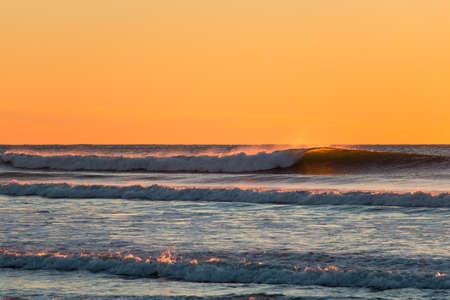 Clean sunset waves breaking at Ocean Beach, San Francisco, California