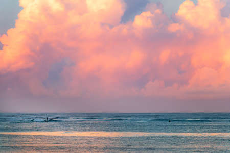 A beautiful sunrise with huge colorful clouds above the ocean in Mexico