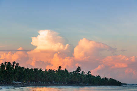 A beautiful sunrise with huge colorful clouds above the ocean in Mexico Archivio Fotografico
