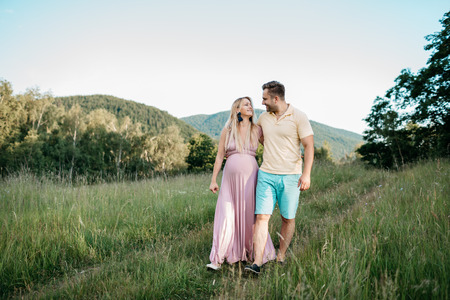 A couple in love walking in the nature on a summer day Фото со стока - 100476418