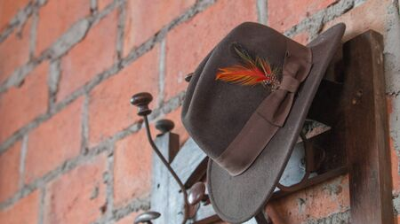 barn boots: hat on wall