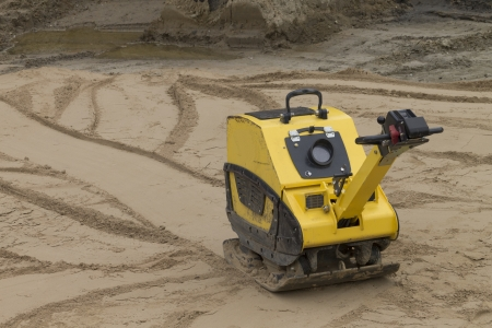 compaction: Compaction of sand before the construction of the road Stock Photo
