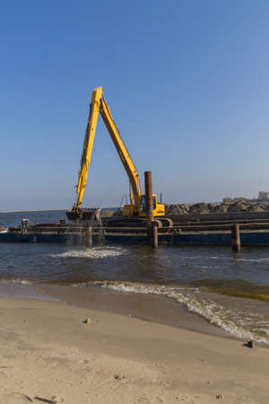Dredging of the delta of the Vistula River, near Gdansk photo