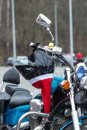 Helmet on a motorcycle of Santa Claus. photo