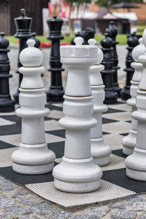 White figures on a large chessboard photo