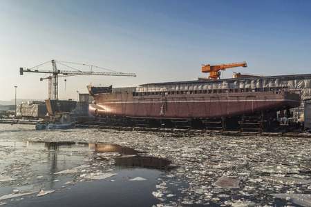 Launching a ship on a frosty winter morning at the shipyard of Gdansk, Poland photo
