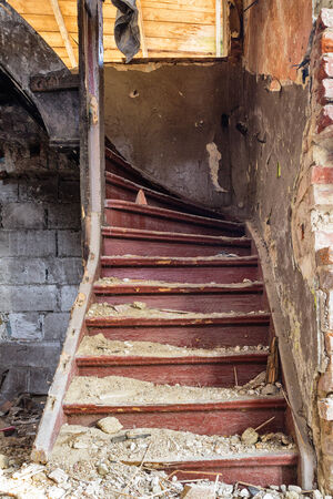 Old staircase in an abandoned house that has been after the earthquake Stock Photo - 25922346