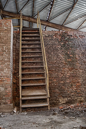 Ladder in an abandoned brick factory and destroyed photo