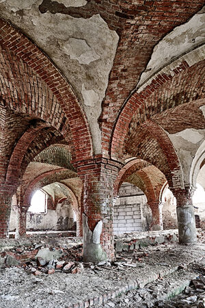 Destroyed stables with brick vault with an pillars photo