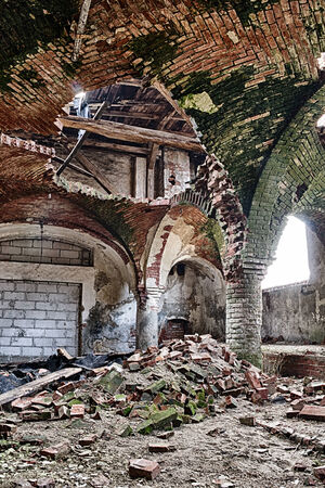 Destroyed stables with brick vault with an pillars Stock Photo