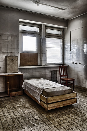 The bed in an abandoned hospital photo