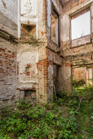 Destroyed room in the ruined palace of vegetation inside Stock Photo