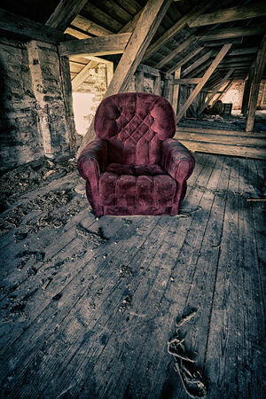 chipped: Red armchair in a barn