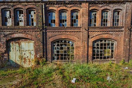 Facade of abandoned building shipyards of Gdansk photo
