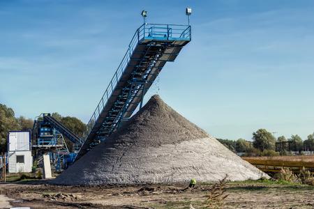 gravel pit: The conveyor belt of sand in gravel pit
