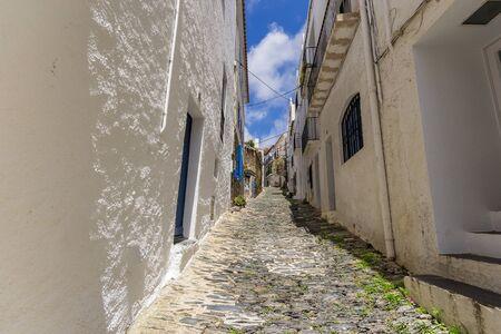 narrowly: Narrow streets in Cadaques, Spain Stock Photo