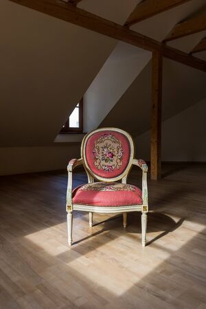 Chair in the attic in an abandoned house