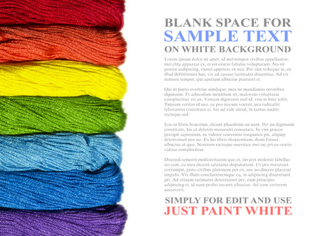 Colorful closeup hanks of threads in rainbow colors for cross stitch isolated on white background. Simple useful template for creative design with sample text Lorem ipsum on blank space Banque d'images