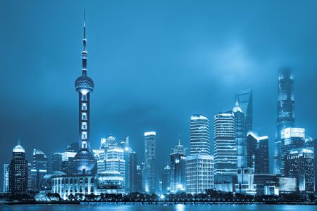 Shanghai landmark view business district at night view in blue tone.