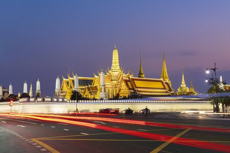 Wat Phra Keaw is most famous landmark of Thailand at dusk viewing from road side.