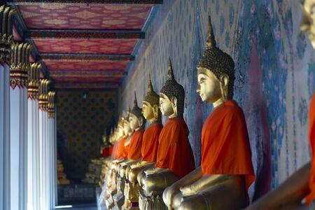 Ancient buddha statue image inside Wat Arun temple in Bangkok, Thailand.