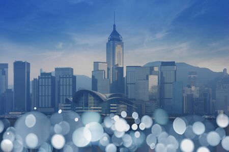 Hong Kong city view in business down town district with bokeh light at foreground in blue tone. Stock Photo