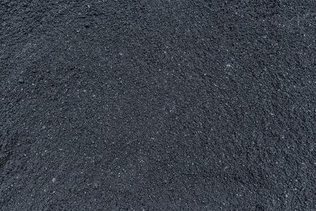 Hot asphalt concrete on road surface not under compression yet