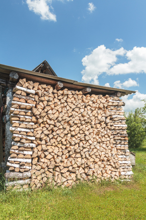 neatly stacked: Stacked birch drying woods with crib end Stock Photo