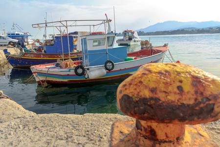 motor boats: Greek fishing moored motor boats are floating near concrete Mastihari bay on Greek Kos island Stock Photo