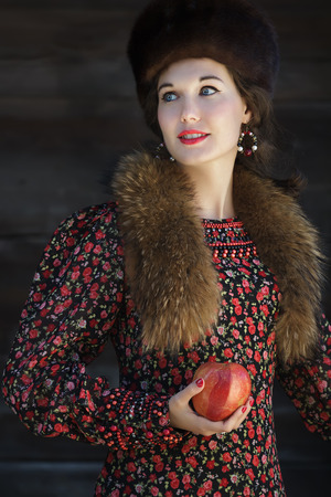 boyar: Portrait of Russian fashion style woman with red ripe apple in arm