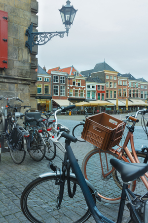 netherlandish: Old town square or Dutch Markt with bicycles parking lot in Delft Netherlands Stock Photo