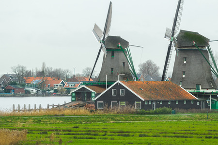 Historic Dutch village with old windmills and calm river landscape