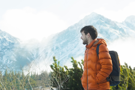 astonishing: Profile of smiling mountaineer is looking at astonishing snowy summits view Stock Photo