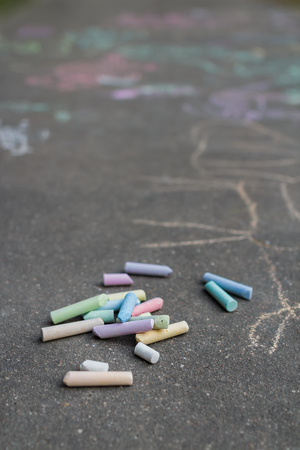 Asphalt surface is covering with sidewalk chalking drawings Stock Photo